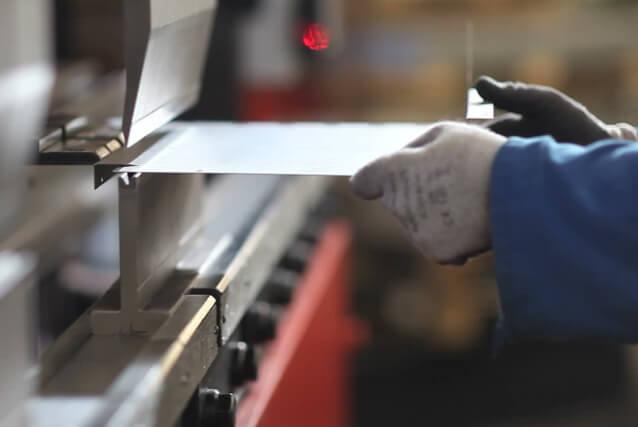 olson custom designs cnc machine shop employee welding
